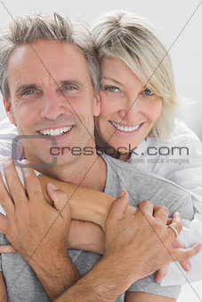 Hugging couple smiling at camera