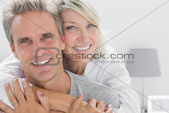 Affectionate couple smiling at camera
