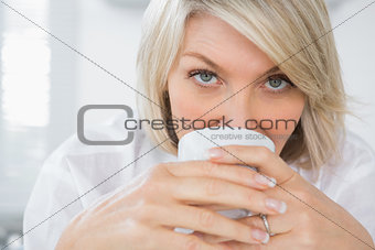 Happy woman drinking coffee in the morning
