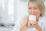 Content woman having coffee in the morning