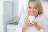 Happy woman having coffee in the morning