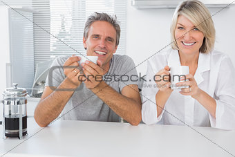 Happy couple having coffee in the morning