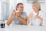 Cheerful couple having coffee in the morning