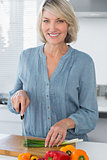 Happy woman preparing vegetables
