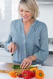 Smiling woman preparing vegetables