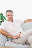 Happy man relaxing on his couch