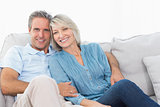 Cheerful couple on their couch