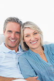 Happy couple relaxing on their couch