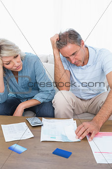 Anxious couple going over bills