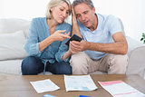 Worried couple going over their debt