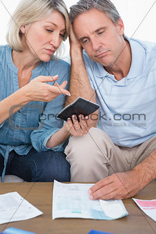 Anxious couple going over their debt