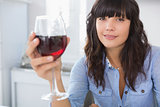 Pretty brunette having glass of red wine