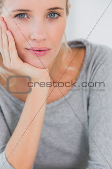 Atrractive blonde woman looking at camera