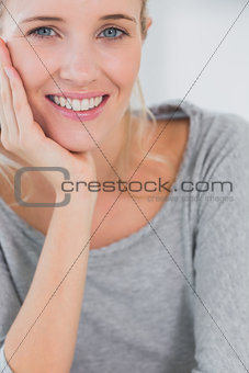 Beautiful blonde woman looking at camera