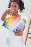 Excited woman pointing to colour charts