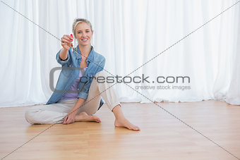 Blonde woman showing new house keys