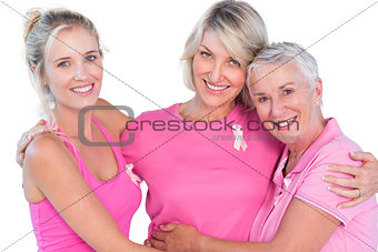Women wearing pink tops and ribbons for breast cancer