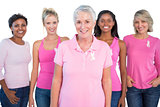 Diverse group of women wearing pink tops and breast cancer ribbons