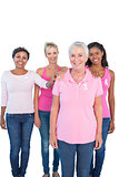 Supportive women wearing pink tops and breast cancer ribbons