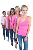 Happy women wearing pink and ribbons for breast cancer