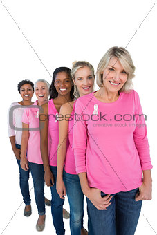 Group of women wearing pink tops and ribbons for breast cance