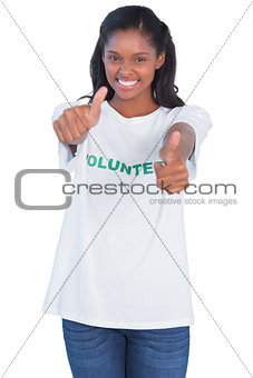 Young woman wearing volunteer tshirt and giving thumbs up