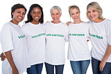 Group of female volunteers smiling at camera