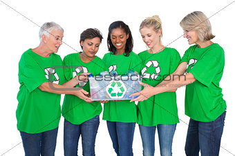 Team of female environmental activists holding box of recyclables