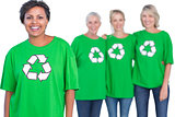 Happy women wearing green recycling tshirts