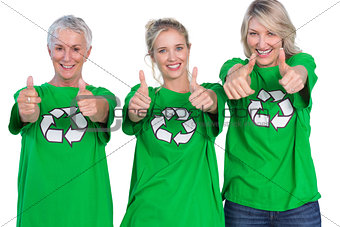 Three women wearing green recycling tshirts giving thumbs up