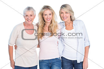 Three generations of women smiling at camera