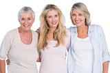 Three generations of  happy women smiling at camera