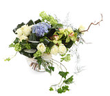 Floral arrangement of white roses, ivy and orchids, isolated ima