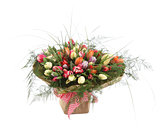 A large bouquet of color tulips in a square vase. Square floral