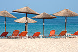 Parasols and sunbeds on beach