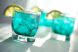 Mint syrup with a slice of lemon and ice cubes