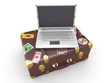Laptop and suitcase