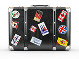 Black leather suitcase with travel stickers.