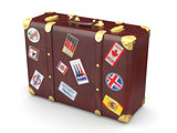 Brown leather suitcase with travel stickers