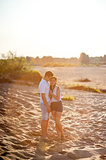 Couple in love walks on the banks of the river
