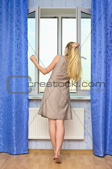 Beautiful Girl Opening Window
