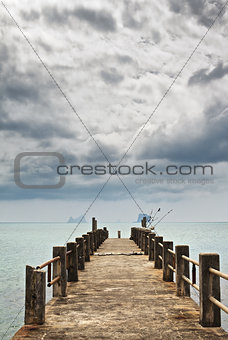 Pier under Dark Clouds