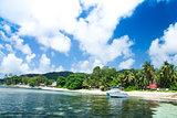 La Digue island, Seychelles, Anse la Reunion. White speedboat.