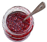 spoon in jar of raspberry jam