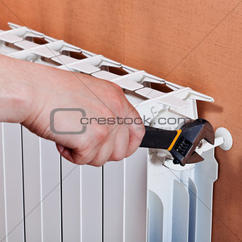 adjusting heating radiator