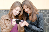 Two teen girls looking on tablet pc
