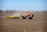 Old agricultural tractor sows