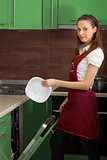 Housewife with the dishwasher