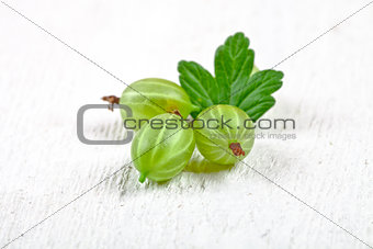 three gooseberries with leaves