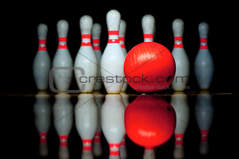 Ten bowling pins and ball